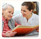 a nurse and an old woman reading a book