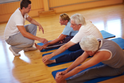 elders exercising with a coach